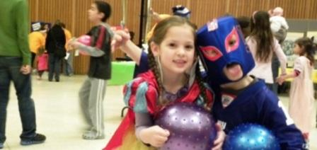 Costumed revelers of all ages filled the Temple for Purim activities